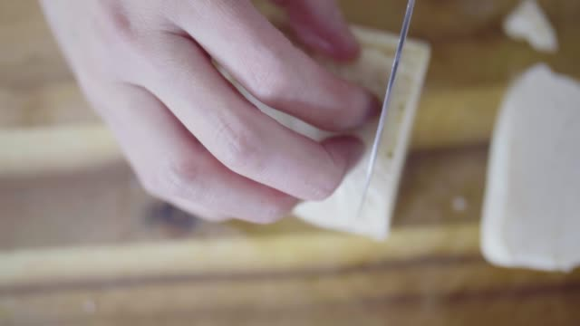 hand cut halloumi cheese on wooden board - slice stock videos & royalty-free footage