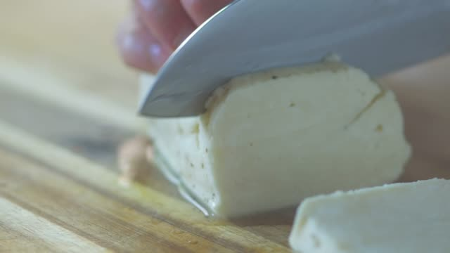 hand cut halloumi cheese on wooden board - plank variation stock videos & royalty-free footage