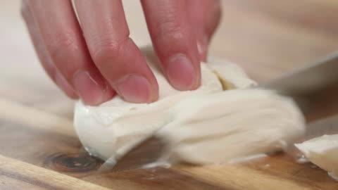hand cut mozzarella  cheese ball - freshness stock videos & royalty-free footage