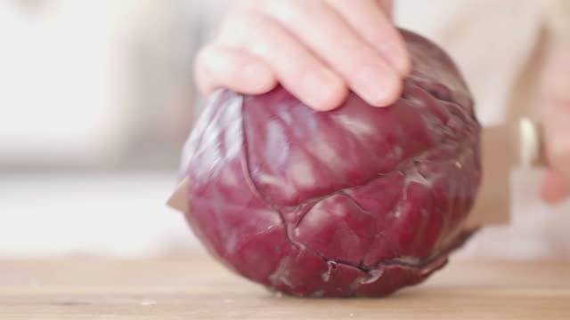 hand cut red cabbage on wooden chopping board - red cabbage stock videos & royalty-free footage