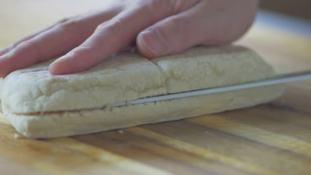 hand cut soda bread on wooden board - plank variation stock videos & royalty-free footage