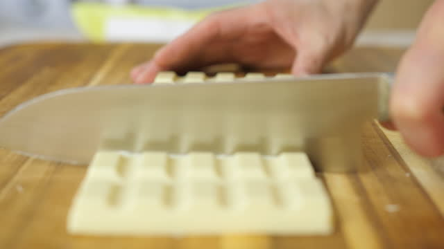 hand cut white chocolate on wooden cutting board - home made stock videos & royalty-free footage