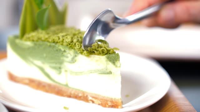 hand cutting matcha cake japanese dessert - cafe macchiato stock videos and b-roll footage