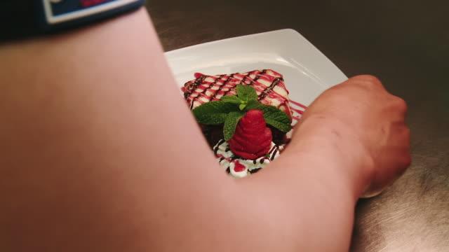 cu hand decorating carrot cake dish / estepona, malaga - food styling stock videos & royalty-free footage