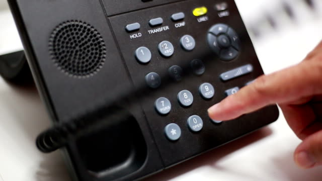 hand dialing number on telephone - landline phone stock videos & royalty-free footage