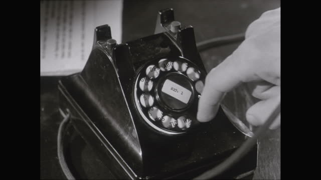 cu hand dialling number on landline telephone / united states - old fashioned stock videos & royalty-free footage