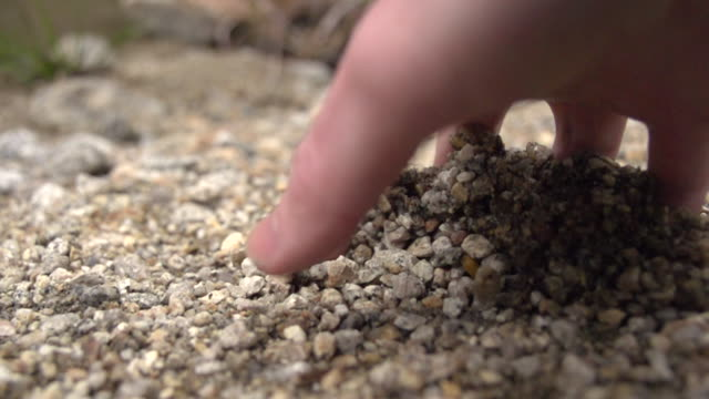 Hand Digging Through Gravel/Sand in Slow Motion
