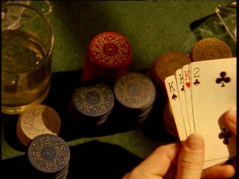 hand displayed in poker game chips pushed in to middle of card table - gambling chip stock videos & royalty-free footage