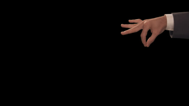 vídeos de stock e filmes b-roll de ms hand drops object - dedo humano