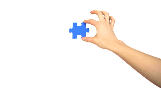 hand fitting piece of puzzle - jigsaw puzzle stock videos & royalty-free footage