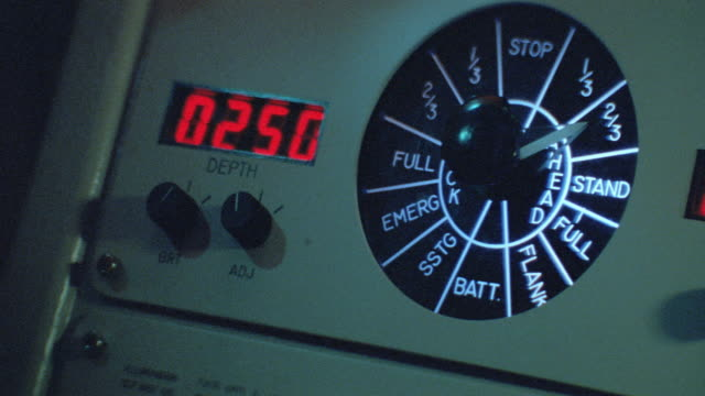 a hand flips the switches and adjusts a dial on a submarine control panel. - 1989 stock videos & royalty-free footage