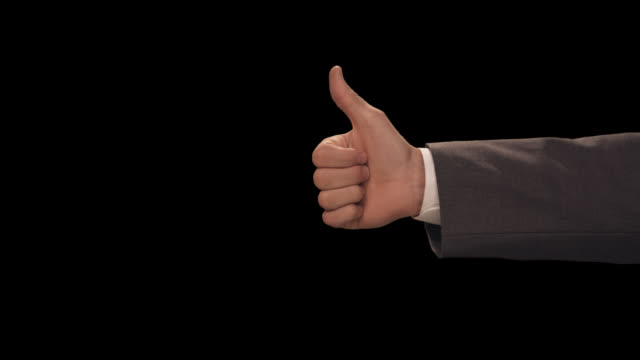 ms hand gives thumbs up then down - thumbs up stock videos & royalty-free footage