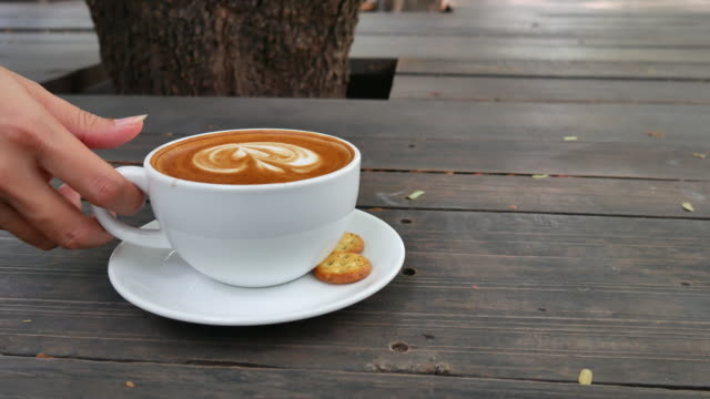 hand grabbing a cup of coffee latte - cup stock videos & royalty-free footage