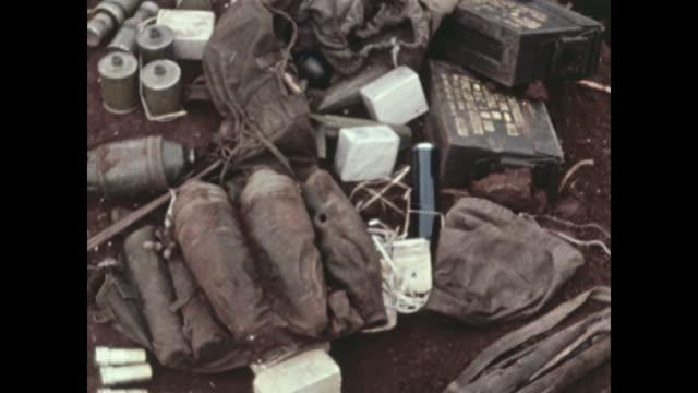 hand grenades explosive bundles called satchel charges and other weapons are collected after an attack by north vietnamese commandos michael... - satchel stock videos & royalty-free footage