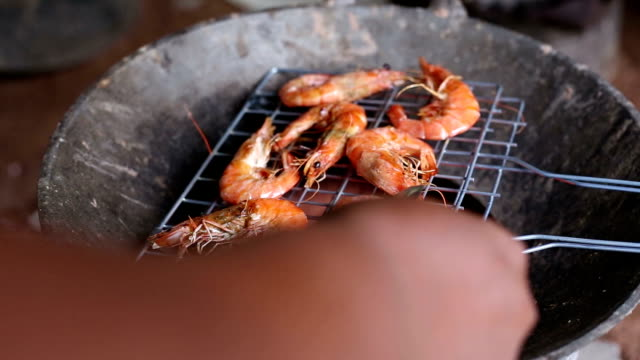 hand grilled shrimp on the stove - prawn animal stock videos and b-roll footage