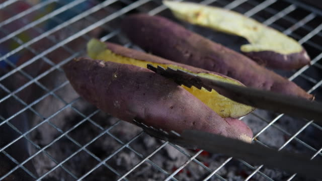 hand grilled sweet potato roasted on stove, street food in thailand - sweet potato stock videos & royalty-free footage