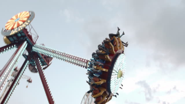 A hand held shot of an amusement park ride in Coney Island, Brooklyn.