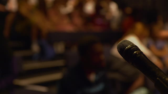 hand held shot of microphone - auditorium stock videos & royalty-free footage