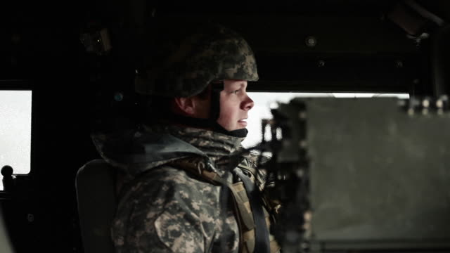 hand held shot of soldier sitting in a humvee. - army soldier stock videos & royalty-free footage