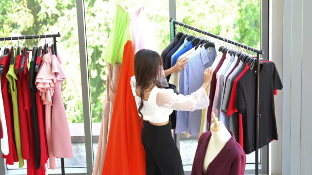 hand held top view: tailor fashion designer working at home - atelier fashion stock videos & royalty-free footage