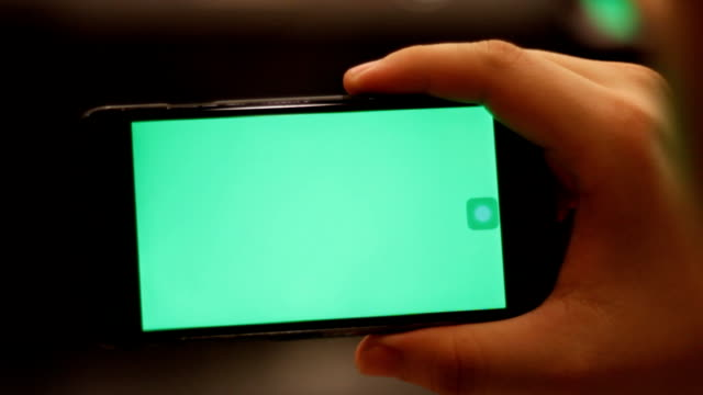 hand hold smartphone green screen