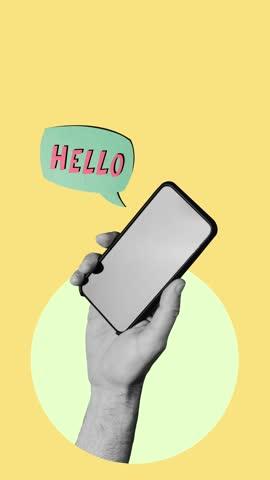 "vídeos y material grabado en eventos de stock de hand holding a smartphone on yellow background while a sign appears with ""hello"" words. - montaje técnica de vídeo"