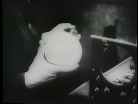 b/w 1945 hand holding cathode ray television tube - cathode ray tube stock videos and b-roll footage