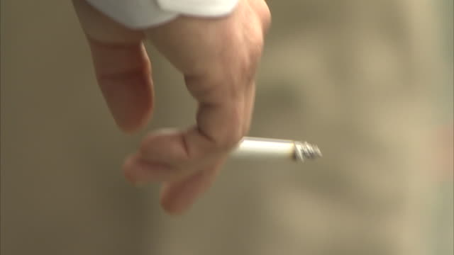hand holding cigarette - smoking issues stock videos & royalty-free footage