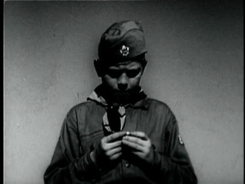 montage b/w cu hand holding compass / ms boy scout checking compass and looking around / usa - boy scout stock videos and b-roll footage