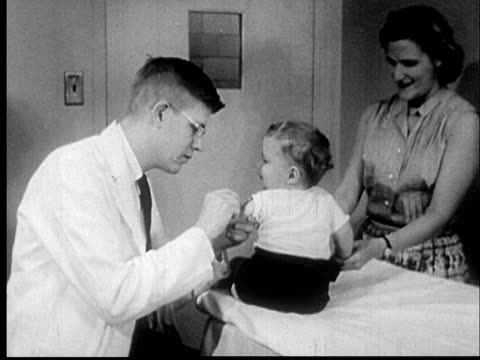 1955 film montage cu hand holding medical needle/ ms doctor giving infant vaccine as mother stands by and watches/ audio - impfung stock-videos und b-roll-filmmaterial
