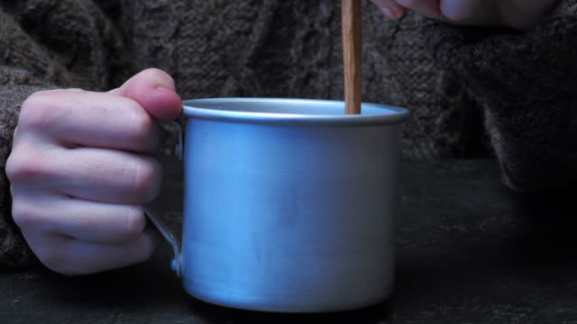 hand holding mug - mug stock videos and b-roll footage