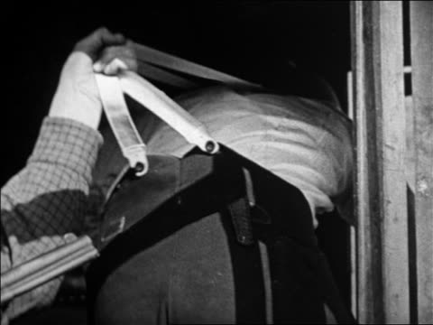 view hand holding onto suspenders of man escaping in holdup / feature - suspenders stock videos and b-roll footage