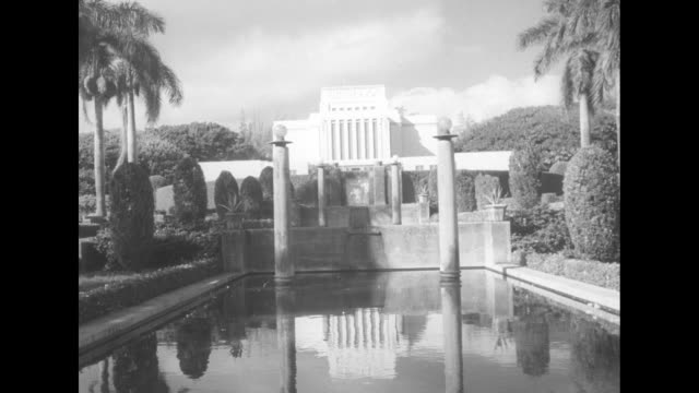 cu hand holding shot card / shot of exterior of laie hawaii temple and avenue leading up to it lined by palm trees / shot of exterior of temple and... - mormonism stock videos & royalty-free footage