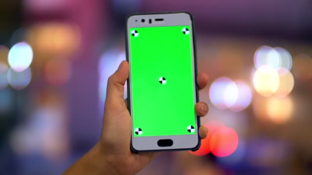 cu : hand holding smartphone at night city light bokeh background - car chroma key stock videos & royalty-free footage