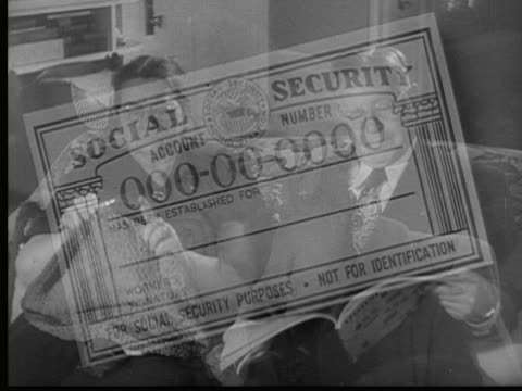1954 b/w montage cu hand holding social security card superimposed over working people / usa - 社会保障点の映像素材/bロール