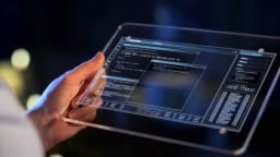 hand holding tablet pc with coding on screen