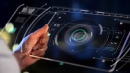 hand holding tablet pc with virtual projections