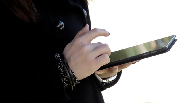 hand holding tablet with touching hand. - porous stock videos & royalty-free footage
