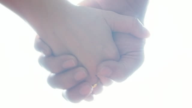 hand holding - holding hands stock videos & royalty-free footage