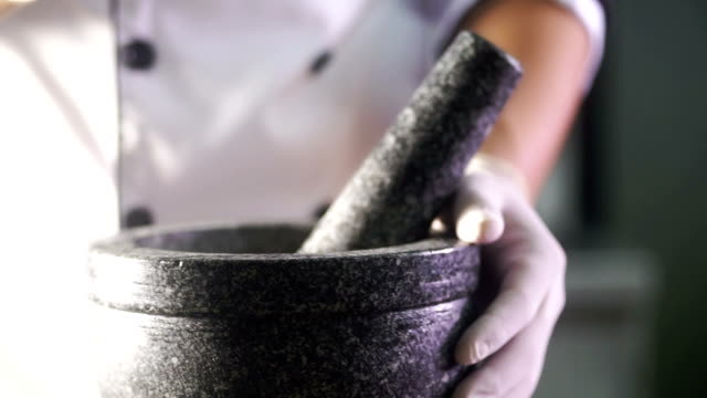 hand holds mortar and pestle. - grinding stock videos and b-roll footage