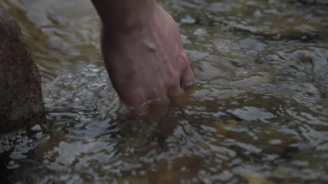 C/U hand in a stream