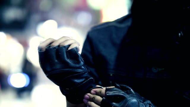 hand in black leather - crash helmet stock videos & royalty-free footage