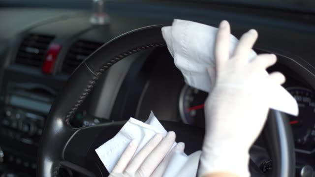 hand in glove wiping down steering wheel. - glove stock videos & royalty-free footage