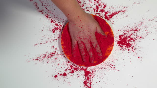 a hand in put in red colour gulal at the holi festival - water fight stock videos & royalty-free footage