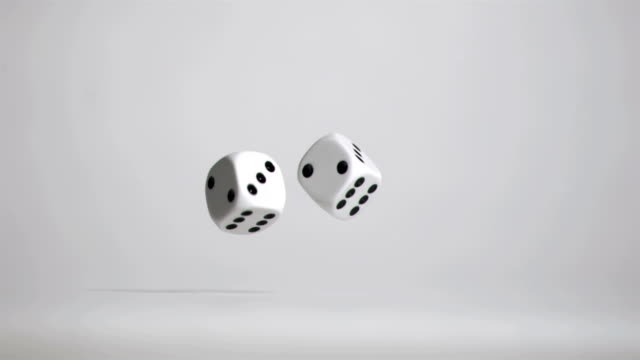 hand in super slow motion throwing a pair of dice - dice stock videos & royalty-free footage