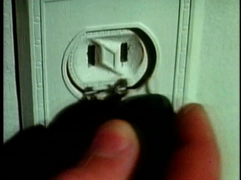 1961 cu hand inserting two pin plug into socket / united states / audio  - plug socket stock videos and b-roll footage