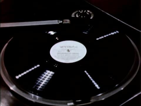 1956 cu ha hand lifting tone arm off of record on radio transcription turntable / usa - schallplatte stock-videos und b-roll-filmmaterial