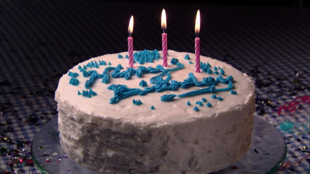 cu, hand lighting and placing birthday candle on cake  - unknown gender stock videos & royalty-free footage