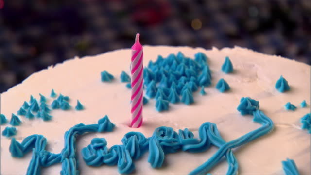 cu, zo, hand lighting birthday candle on cake  - unknown gender stock videos & royalty-free footage