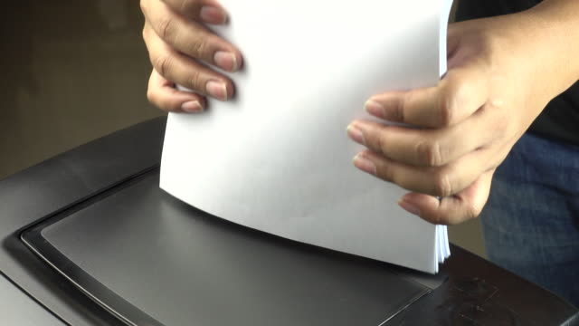 4k : hand loading paper to printer - printer occupation stock videos and b-roll footage